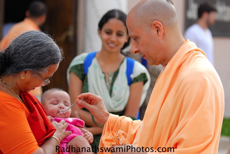 Radhanath Swami giving a name to a child