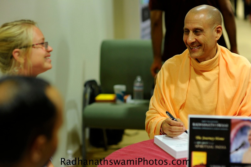 Radhanatha Swami signing his book - The Journey Home