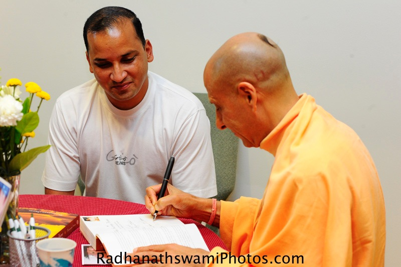 Swami Radhanath Signing his Book - The Journey Home2