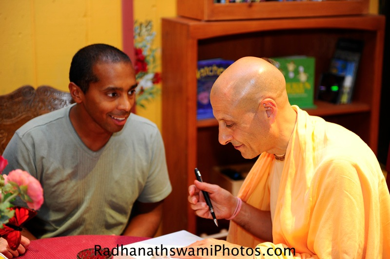 Radhanath Swami speaking to guests at Soul Food Book store