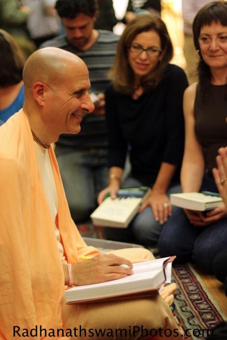 Radhanath Swami signing his book at Jivamukti Yoga Center