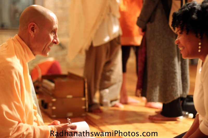 Radhanatha Swami Signing his Book The Journey Home