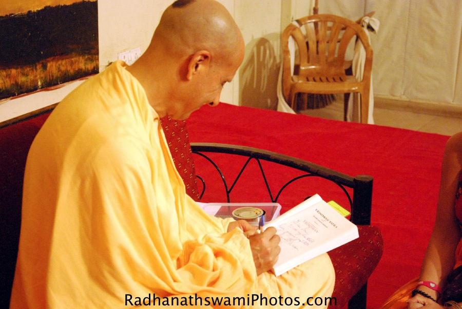 Radhanath Swami Signing his book