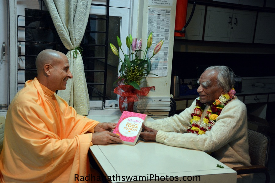 BKS Iyengar giving his book to Radhanath Swami