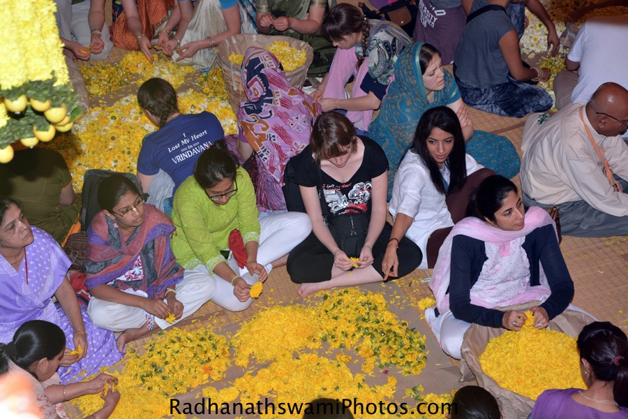 Devotees plucking the flower petals for lord