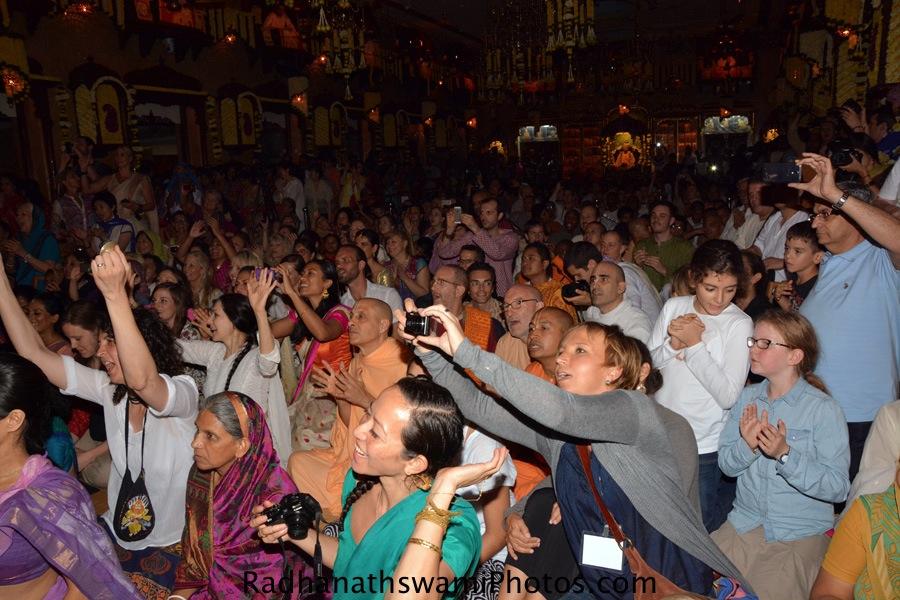 Devotees taking darshan of lord while flower abhishek
