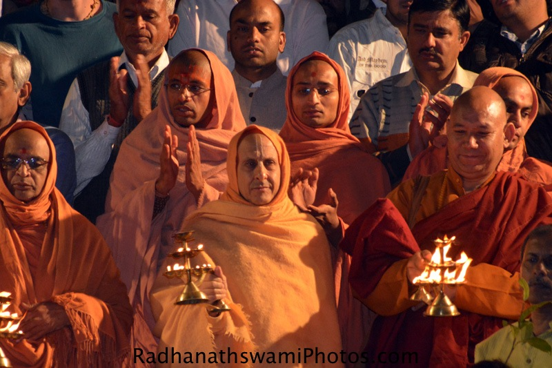 Radhanath Swami doing arati to Mother Ganges