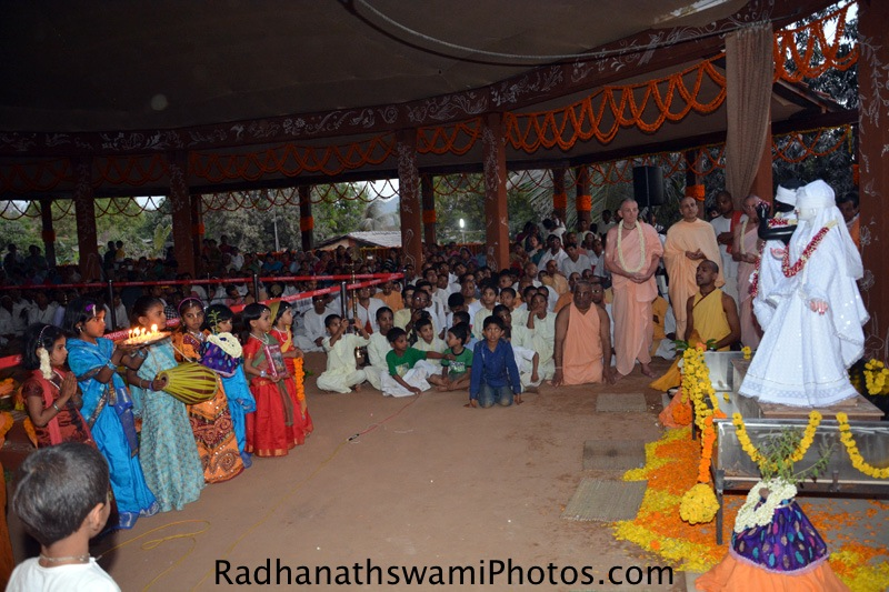 Children doing Arati to Lord