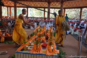 Devotees preparing for fire sacrifice