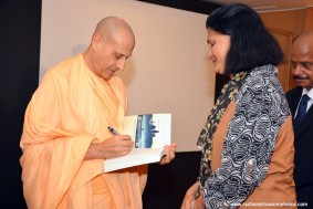 Radhanath Swami signs the journey home book