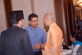Radhanath Swami with officers at CLO Summit