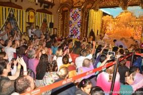 People watching flower abhishek for the dieties - Radhanath Swami