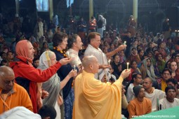 Radhanath Swami offering lamp