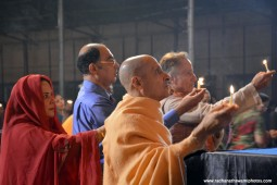 Radhanath Swami offering lamp to lord damodar