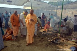 Radhanath Swami watching devotees cook