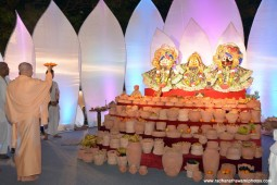 Radhanath Swami doing Arati to their lordships