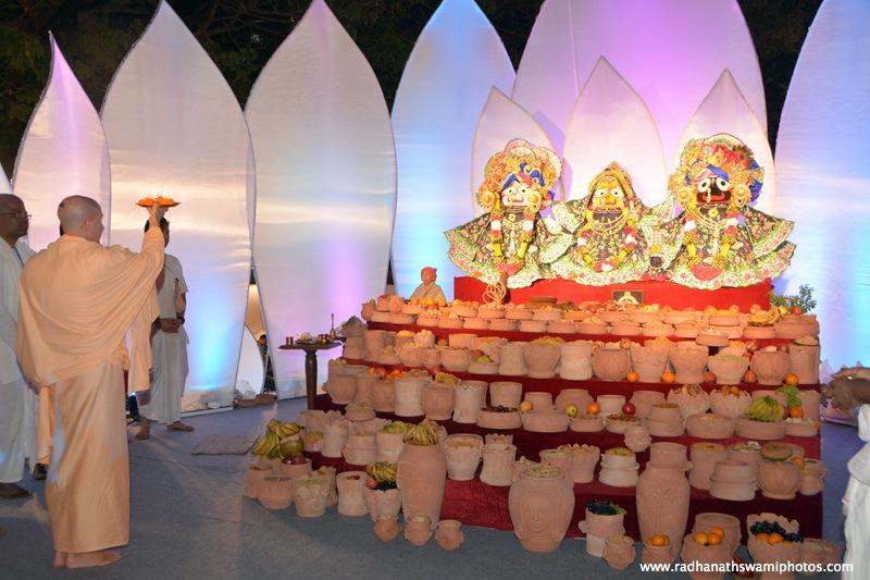 Radhanath Swami doing Arati to their lordships