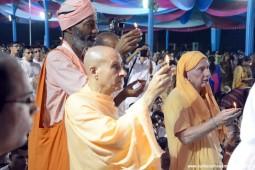 Radhanath Swami offering lamp to Lord Damodara