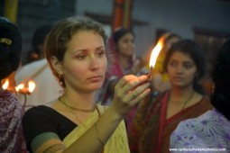 Devotee offering lamp to Lord Damodara