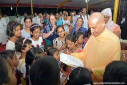 Radhanath Swami seeing the art by devotee children